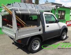 Suzuki Jimny PickUp mit Planenaufbau und Dachlastträger für die perfekte Sommernutzung