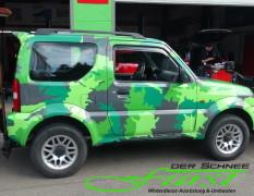 Suzuki Jimny Limousine mit THE BOSS 200cm V-Pflug und TGS600 Heckanbaustreuer