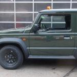 grüner neuer SUZUKI Jimny Automatik als Winterdienstfahrzeug mit THE BOSS HTX 185 cm Schneeschild sowie THE BOSS TGS600 Heckanbaustreuer